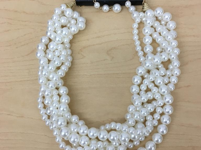 Lot Of 8 Women's Jewelry Includes: 1 Faux Pearl Necklace & Earrings,  2 Pairs Cubic Zirconia Earrings, 2 Floral Necklace & Earring set. Retail: $29.73